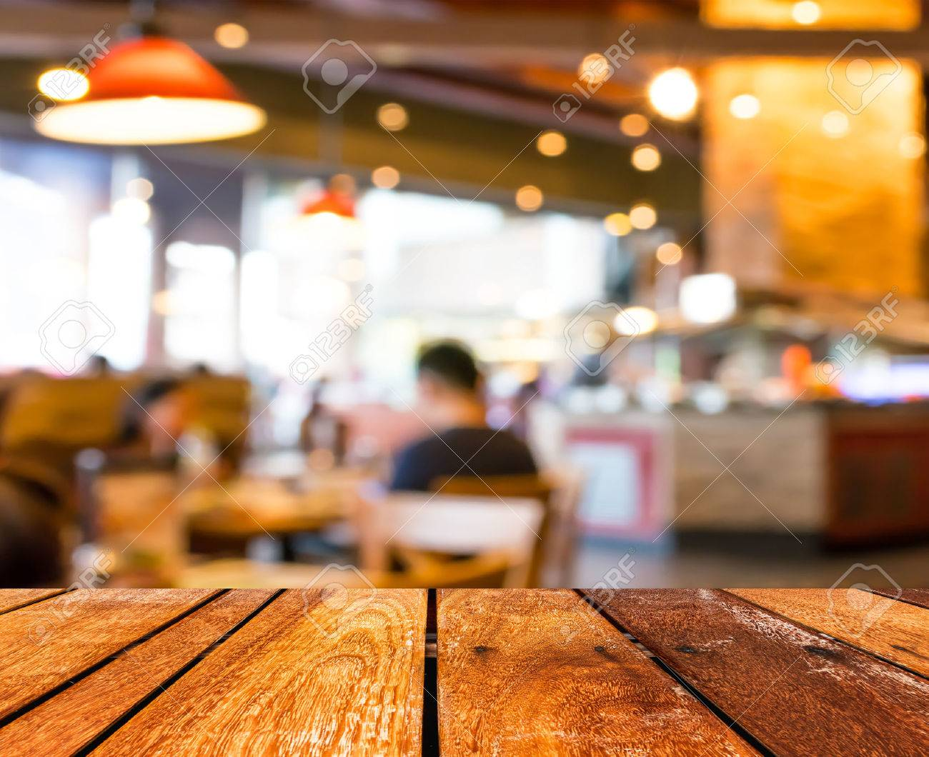 Empty wood table and blurred living room background stock photo - Empty Wood Table And Coffee Shop Blur Background With Bokeh Image Stock Photo 38850573