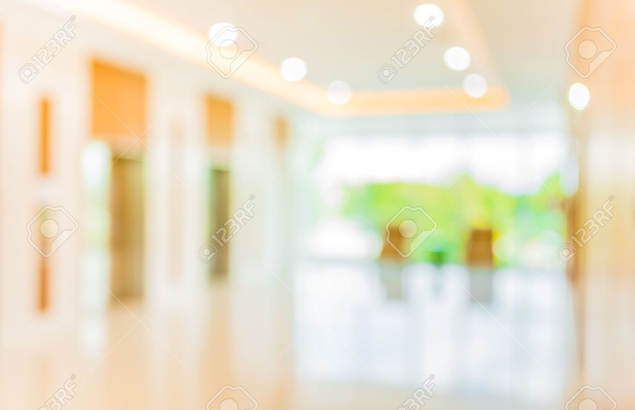 Blur Image Of Hospital Office Room With Table And Chairs For