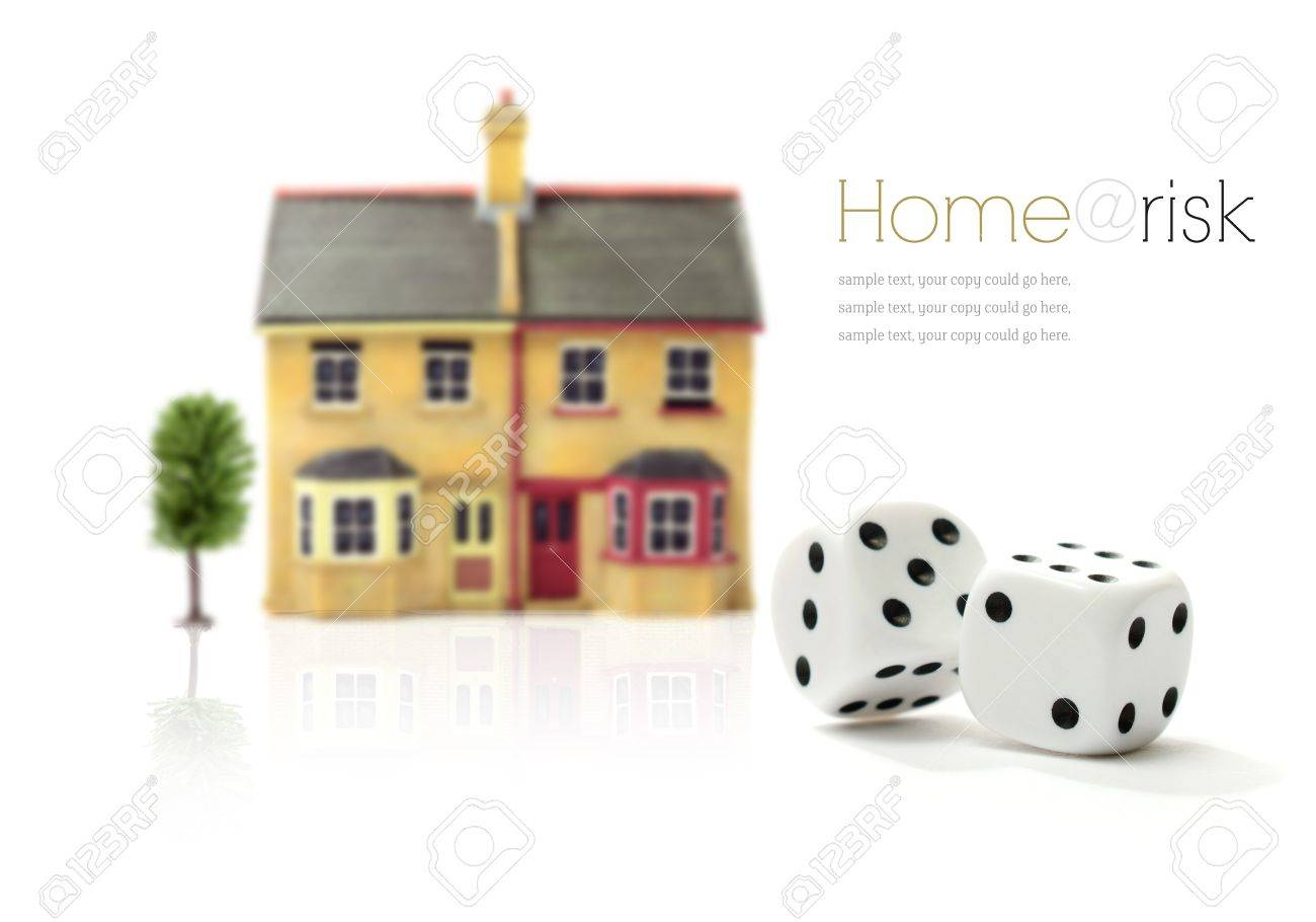 Investment risk concept stock photograph. Rolling dice and property against a white background. Copy space. Stock Photo - 19198415