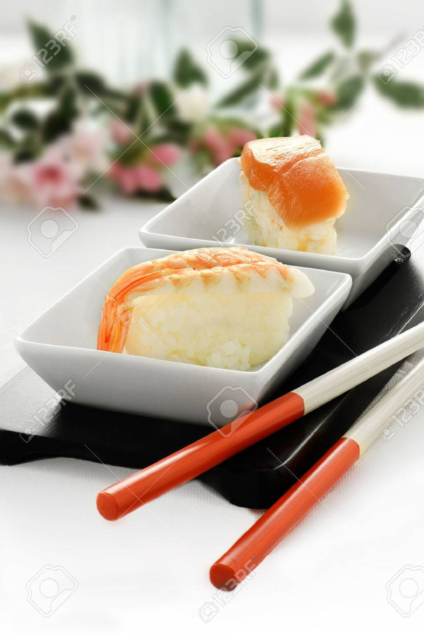 Fresh Japanese sushi in traditional asian table setting with salmon and shrimp delicacies chop sticks & Fresh Japanese Sushi In Traditional Asian Table Setting With.. Stock ...