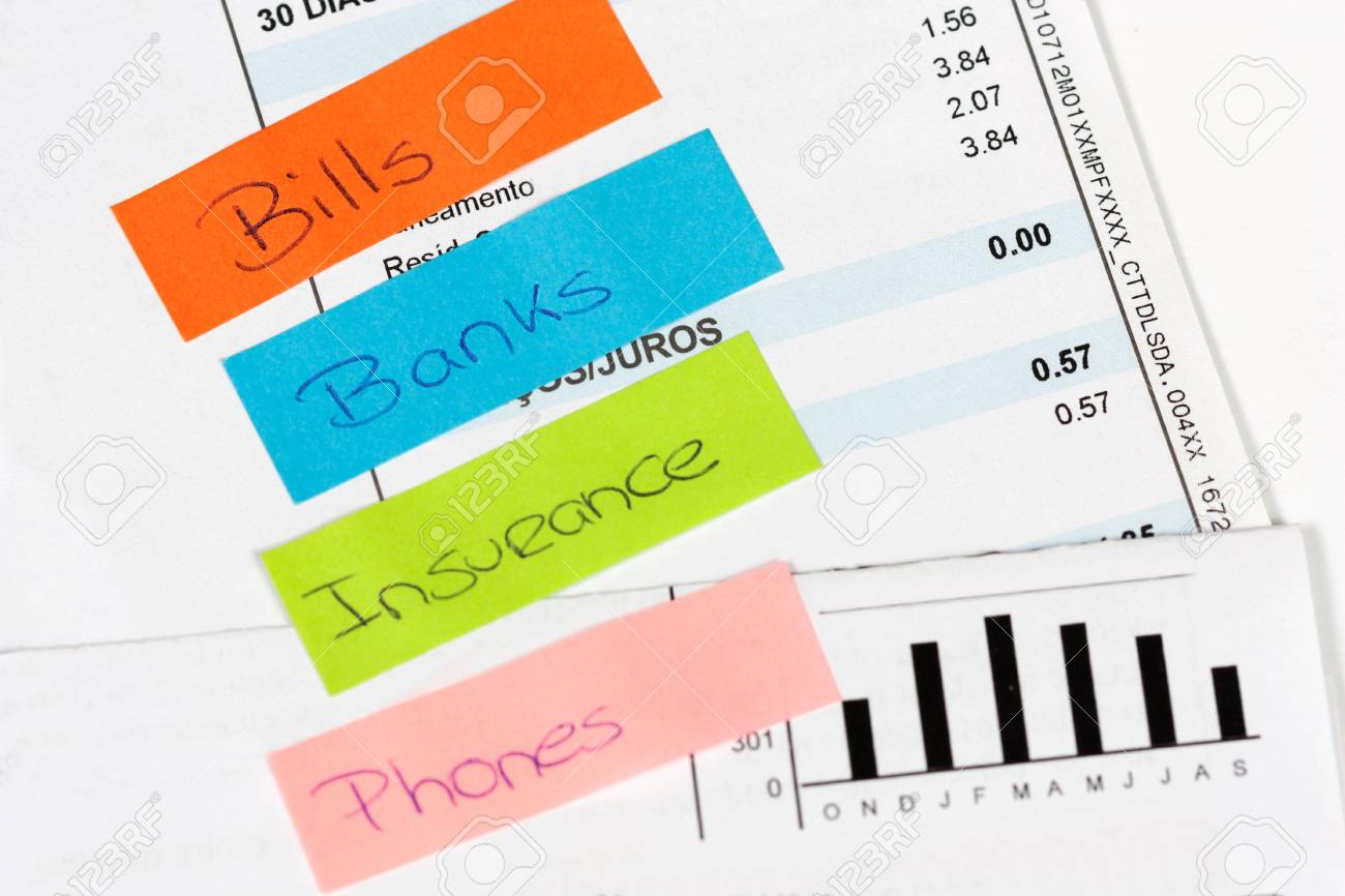 Some bills to pay with some post-it words Stock Photo - 17446434