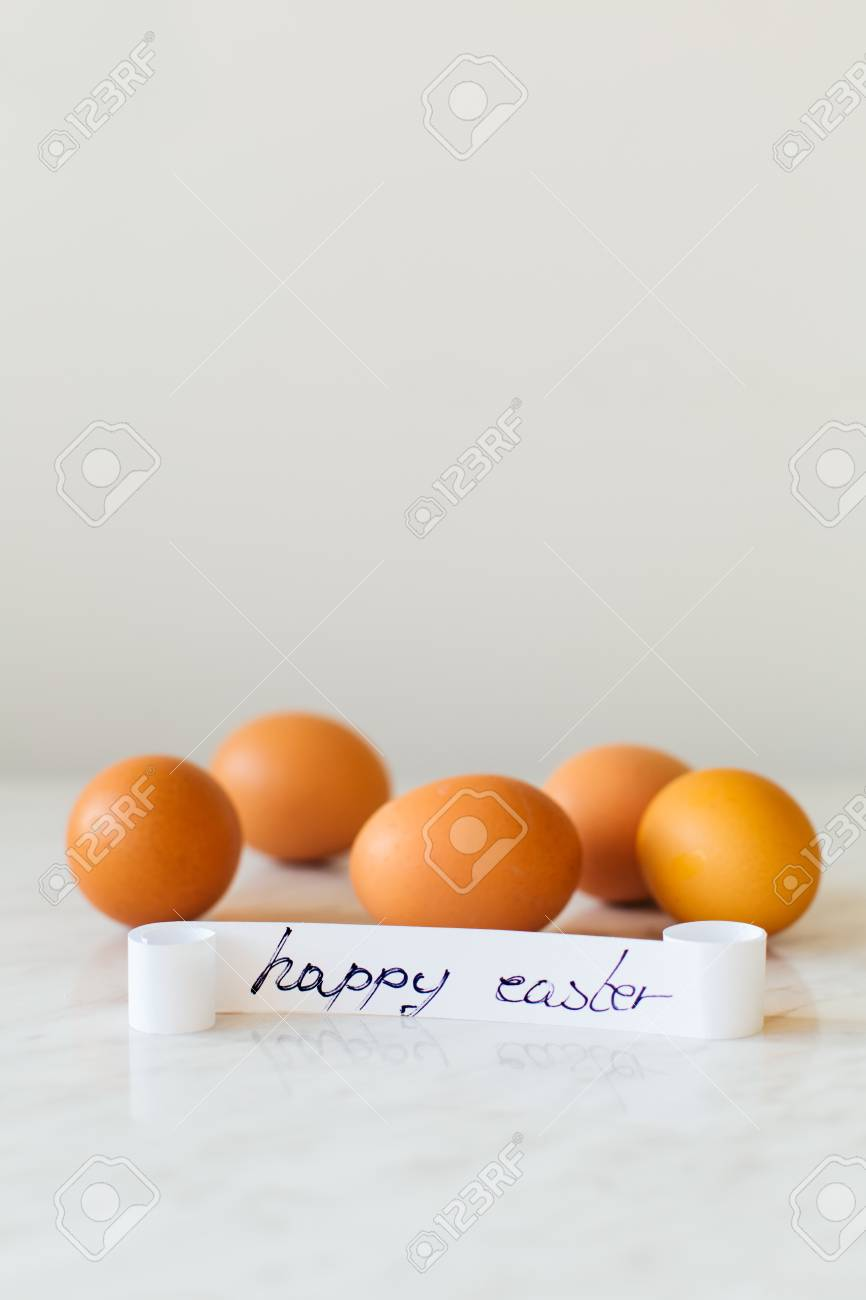 Easter Concept Happy Easter Greeting Card And Raw Eggs With Stock