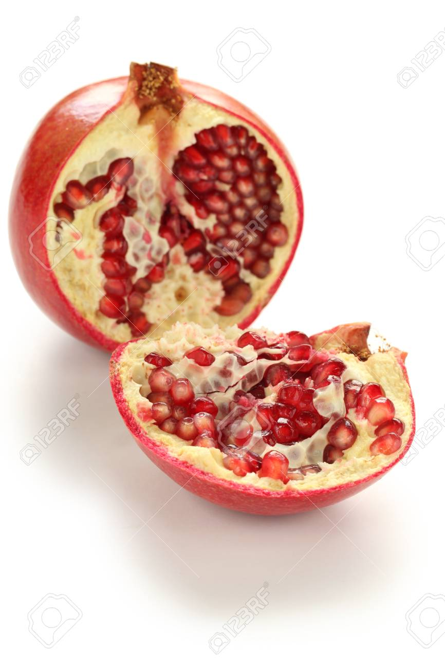 half cut pomegranate isolated on a white background Stock Photo - 17215517