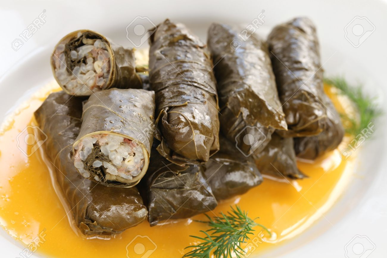 http://previews.123rf.com/images/cokemomo/cokemomo1302/cokemomo130200060/18166909-dolma-stuffed-grape-leaves-with-egg-lemon-sauce-turkish-and--Stock-Photo.jpg