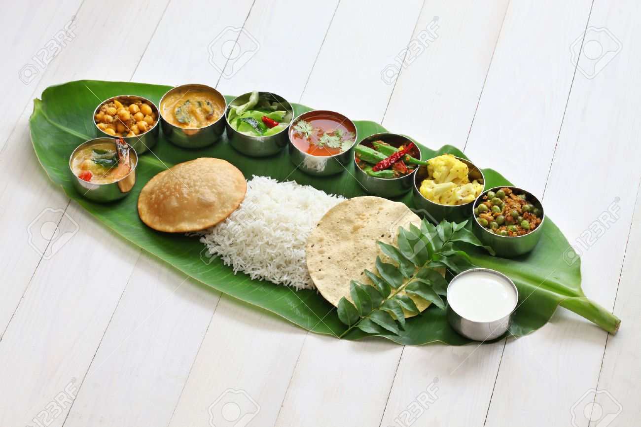 meals served on banana leaf, traditional south indian cuisine Stock Photo - 43624574