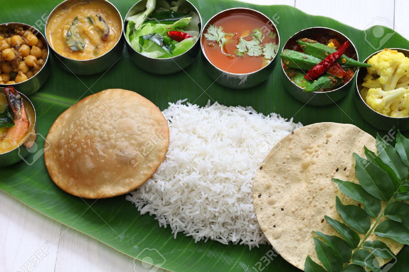 meals served on banana leaf, traditional south indian cuisine Stock Photo - 43624571