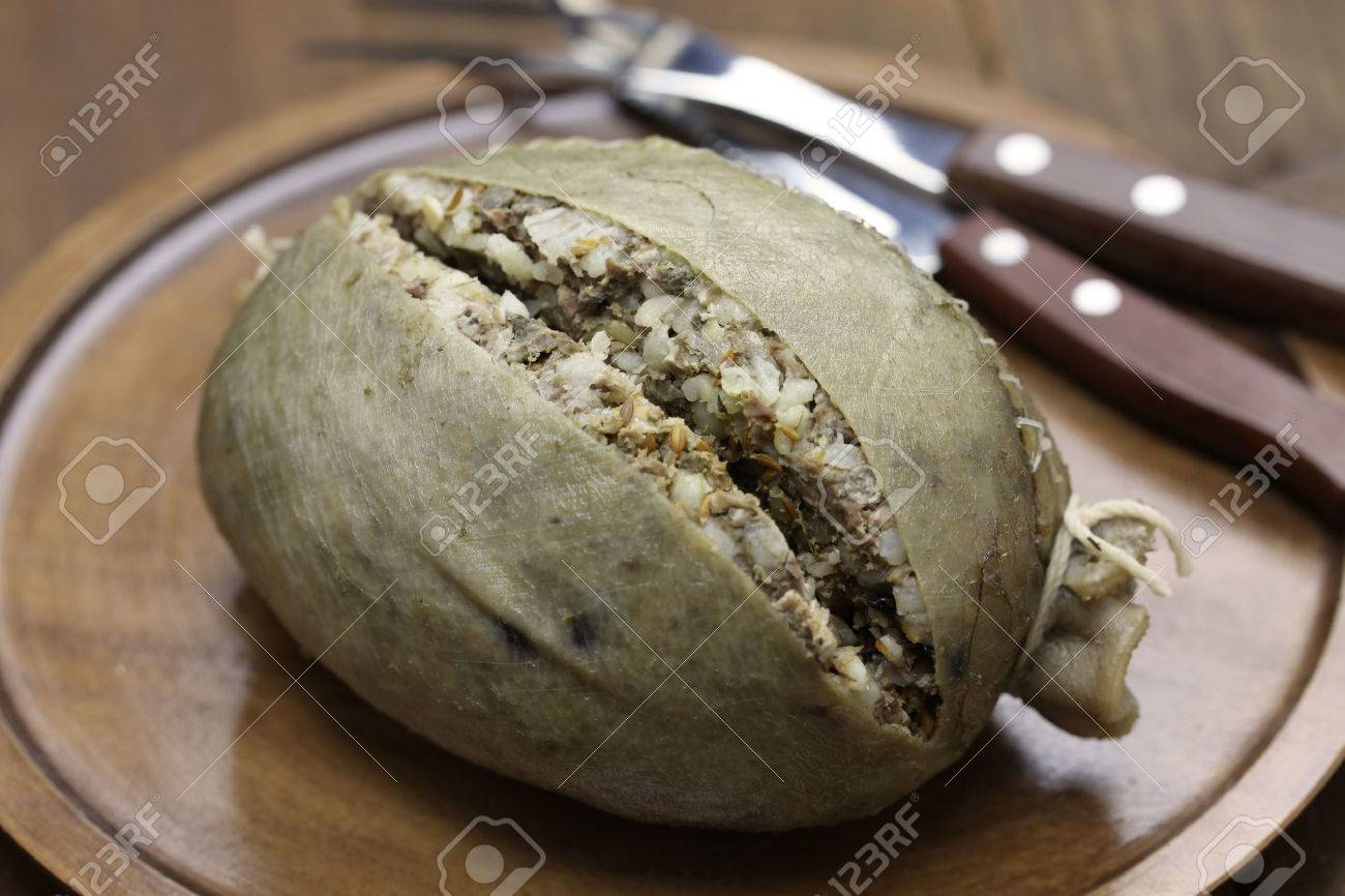 homemade haggis, scotland food isolated on wooden background Stock Photo - 43685567