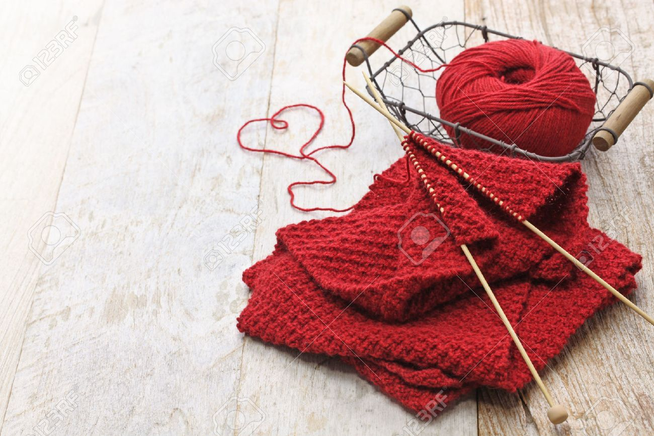 hand knitted red scarf and heart shaped thread - 55939796