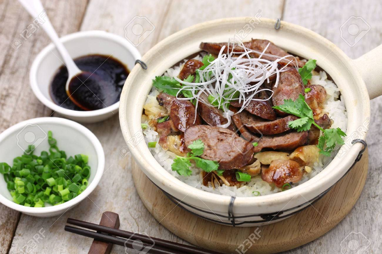 cantonese food, Chinese sausage and chicken with rice in clay pot Stock Photo - 56519802