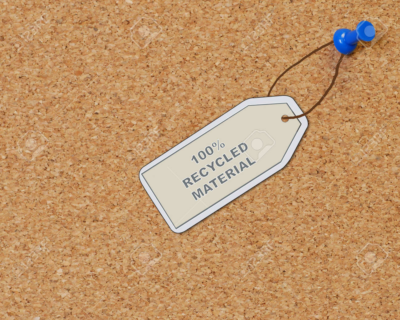 recycled material tag attached to corkboard with thumb tack Stock Photo - 2478965