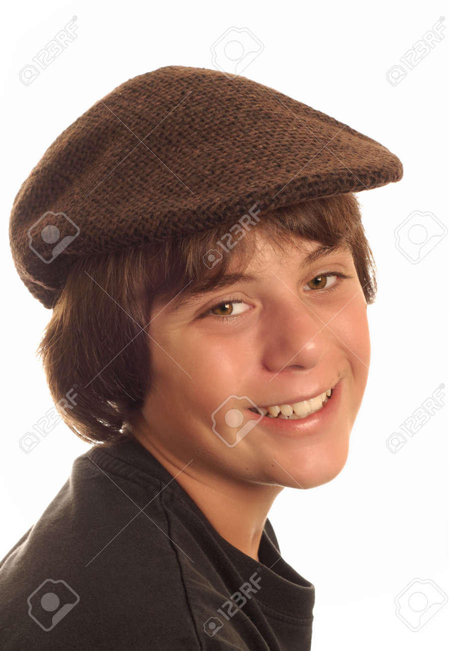 attractive thirteen year old boy wearing a flat cap isolated on white  background Stock Photo - c9d66d8887a