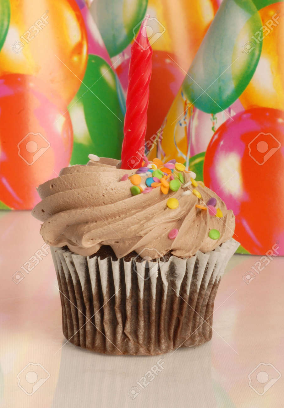 chocolate cupcake with one candle and a birthday background Stock Photo - 4481997