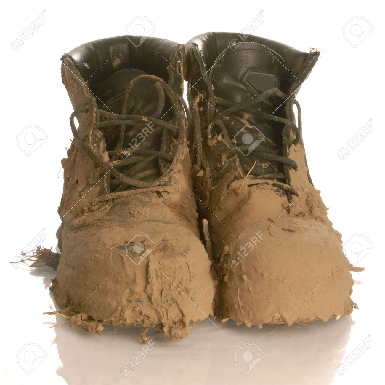 muddy work boots isolated on a white background Stock Photo - 4616933