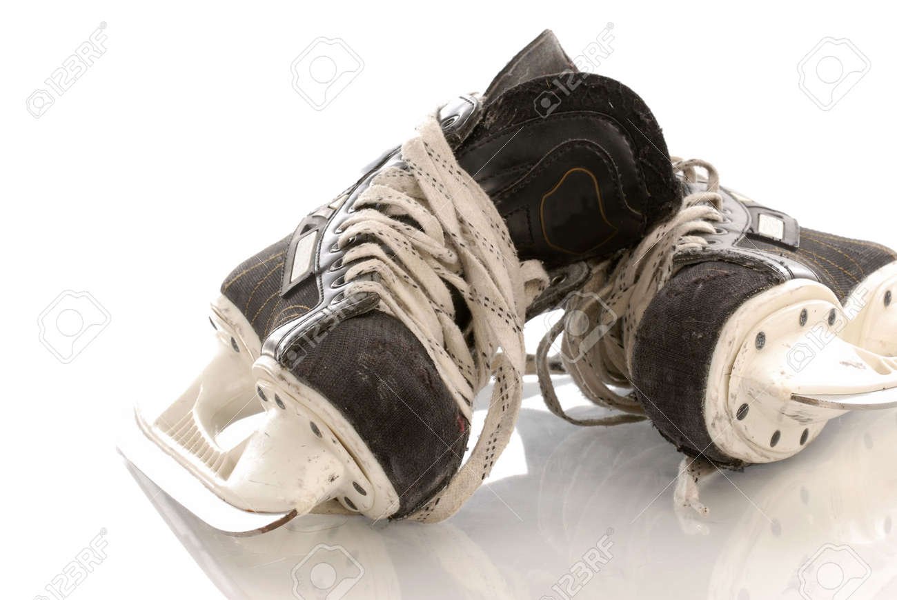 ice hockey skates with reflection on white background stock photo