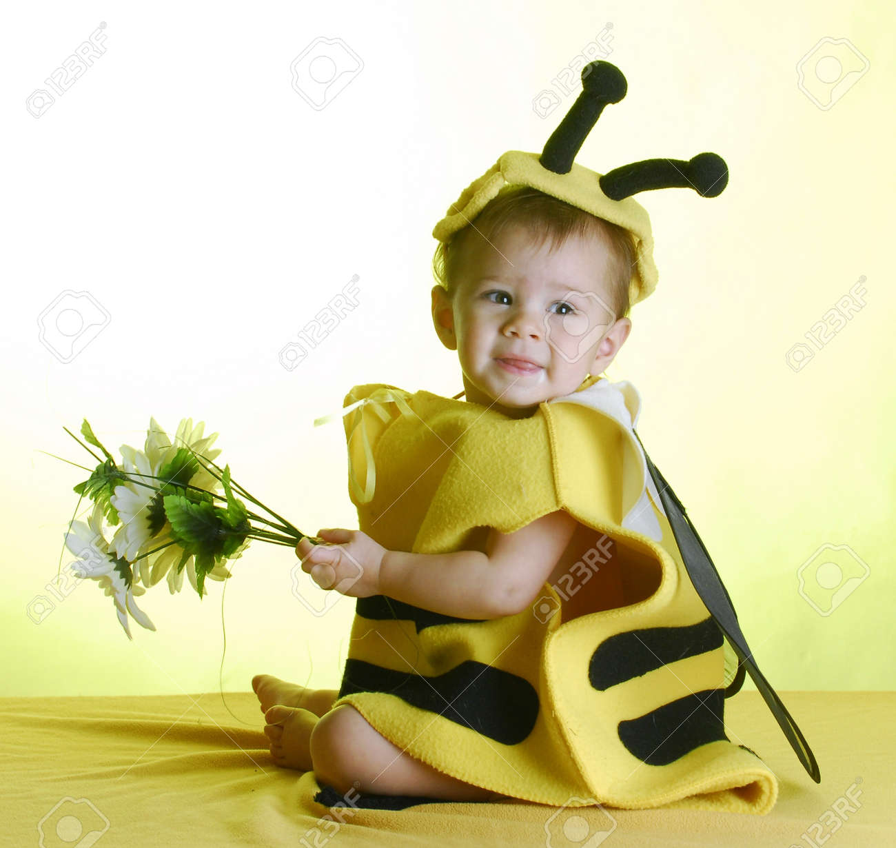 cute baby wearing bee costume on yellow background Stock Photo - 7825259
