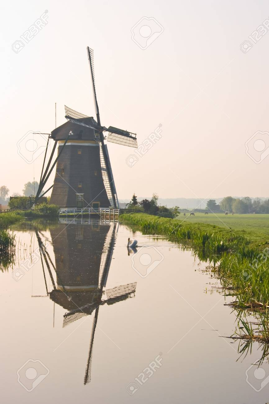 Dutch watermill at the waterside with reflection after sunrise Stock Photo - 4810838
