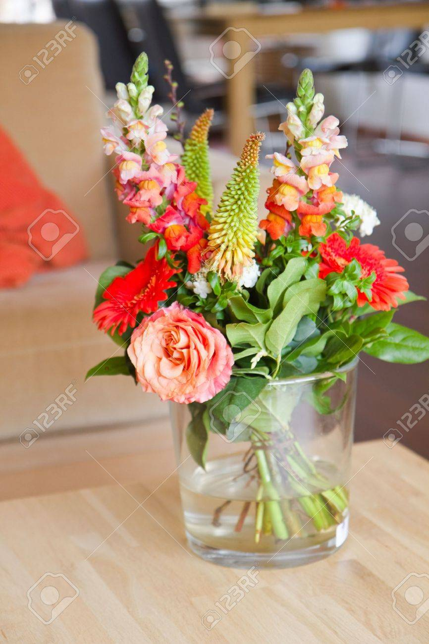 Flowers bouquet stock photos royalty free flowers bouquet images modern interior with bouguet of flowers in glass vase on table izmirmasajfo