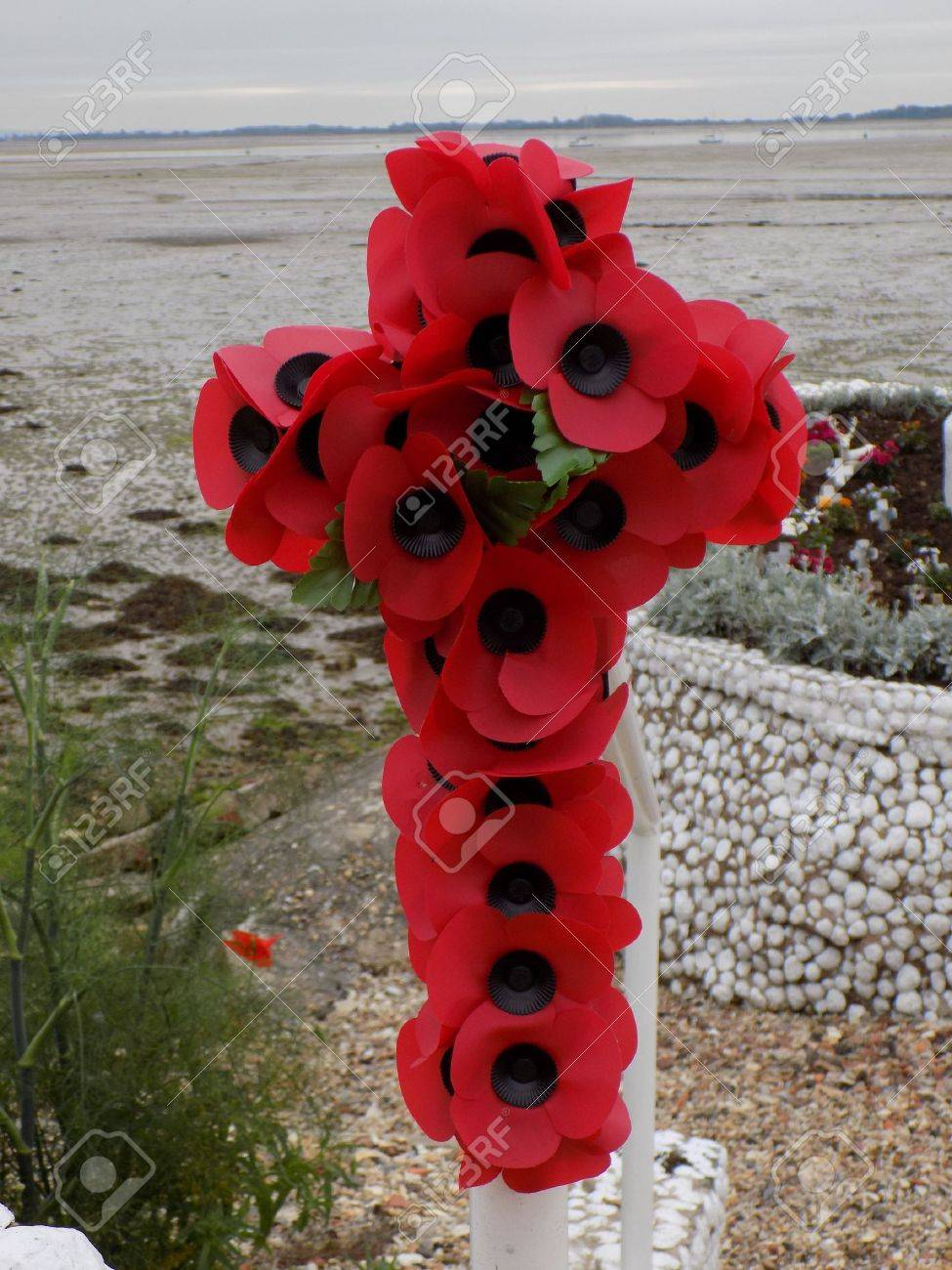 Cross made from paper poppies the poppy has been used for many cross made from paper poppies the poppy has been used for many years as a buycottarizona Images