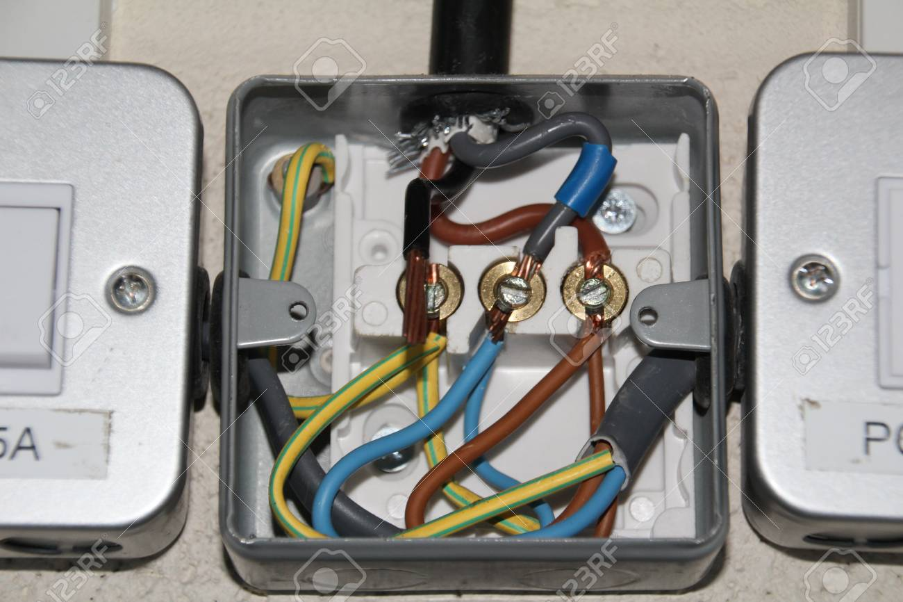 Domestic wiring in a metal surface mount junction box. Stock Photo -  84889979