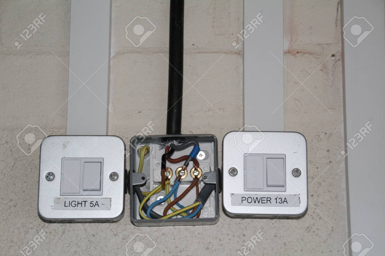 Domestic wiring in a metal surface mount junction box. Stock Photo -  84889980
