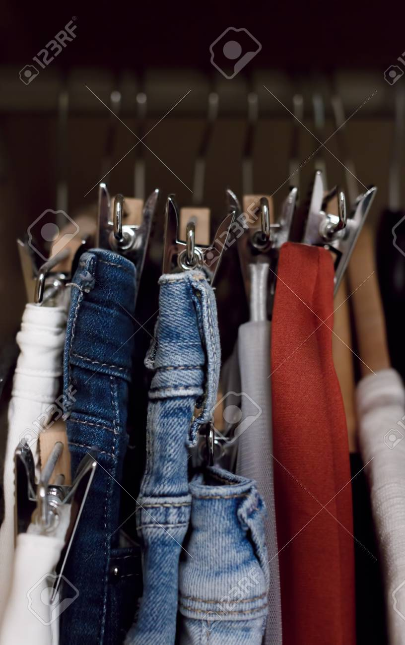 Stock Photo   Various Clothes Hanged In Wardrobe. Clothes Hang In The Closet.  Jeans And Skirts On Chrome Plated Clothespins. Tightly Hanging Clothes In  The ...