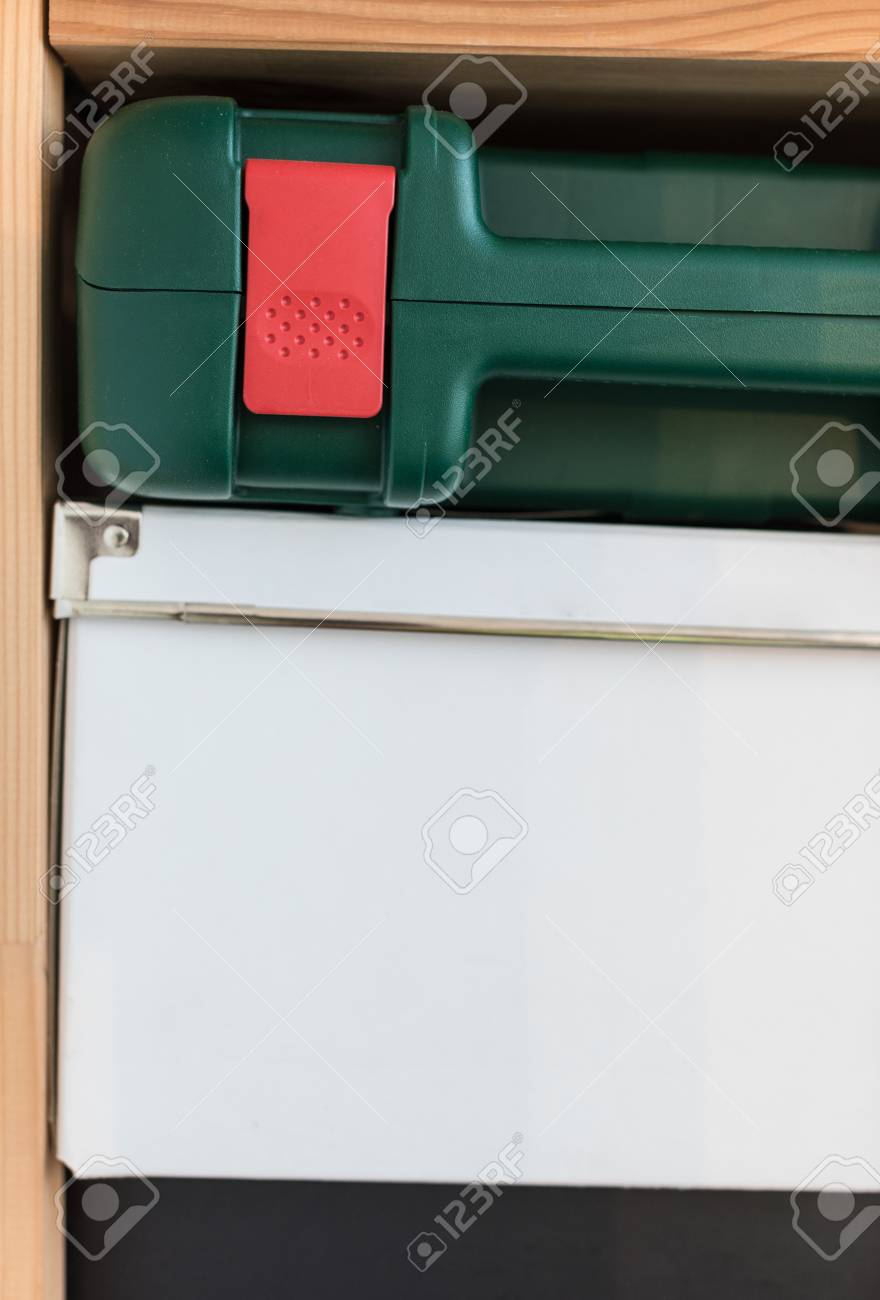 Stock Photo   Storage Of Things On A Wooden Rack. A White Cardboard Box And  A Green Tool Box On A Wooden Shelf. A Pile Of Boxes In The Closet.