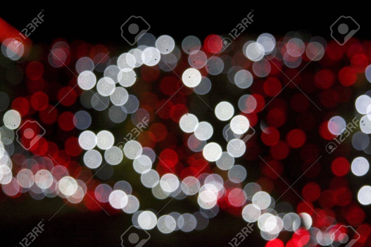 Red And White Christmas Lights.Out Of Focus Red And White Christmas Lights Against A Black Background