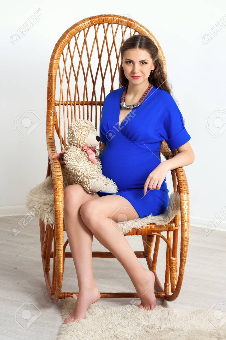 Phenomenal Pregnant Girl In A Blue Dress Sitting In A Rocking Chair Creativecarmelina Interior Chair Design Creativecarmelinacom