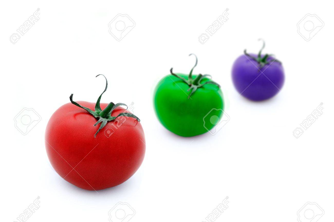 Conceptual illustration of three tomatoes in RGB colours over white background. Shallow depth of field. Stock Illustration - 2651581
