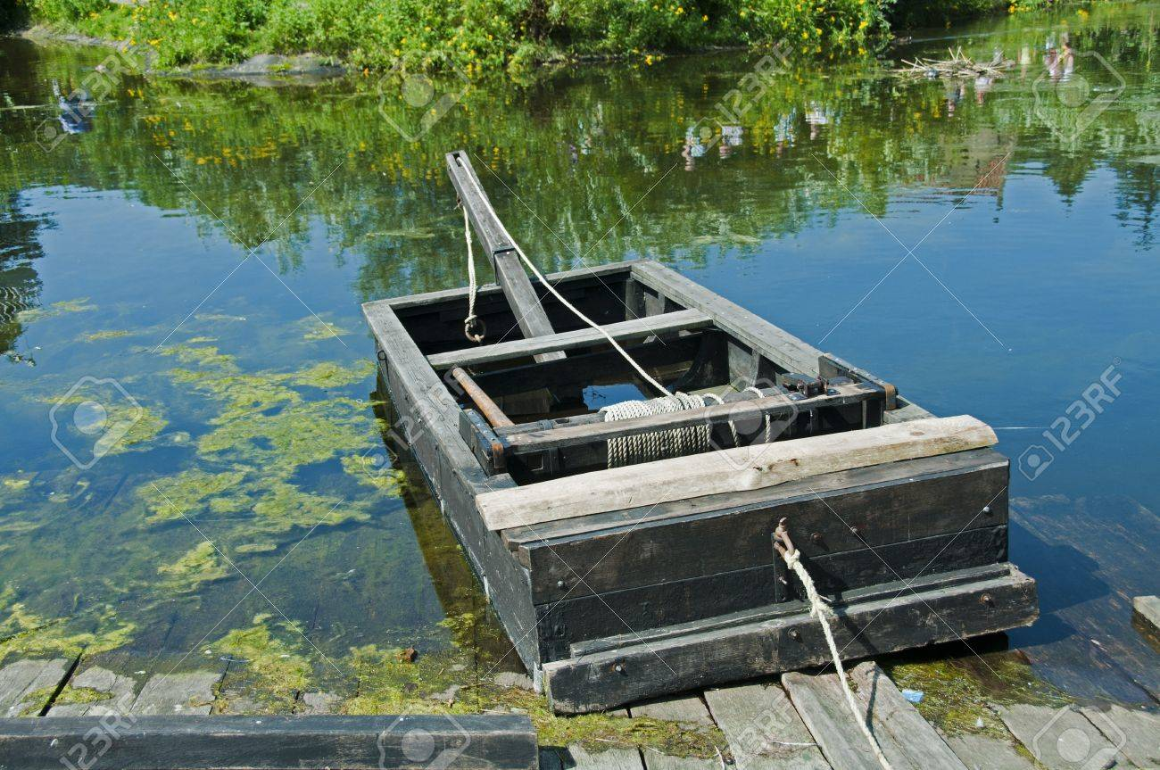 Old Wooden Boat With A Rope To Pull To The Other Side Stock Photo ...