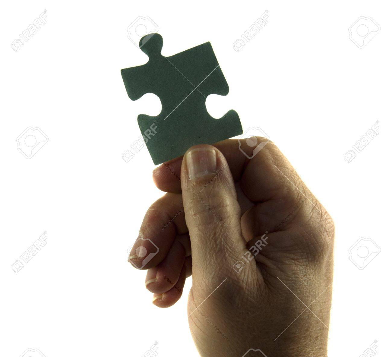 hand holding puzzle Stock Photo - 13078078
