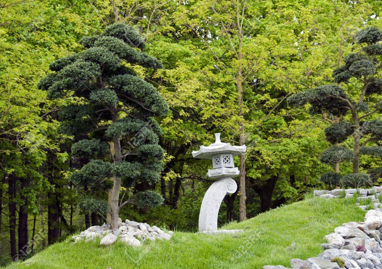 Bonsai Trees And Concrete Structure In Japanese Garden Stock Photo