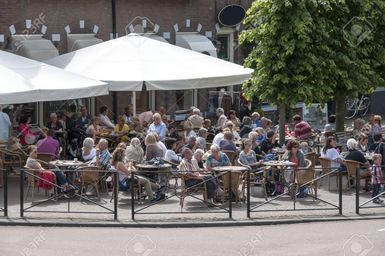 people having fun on a terrace in Middelharnis - 14521218
