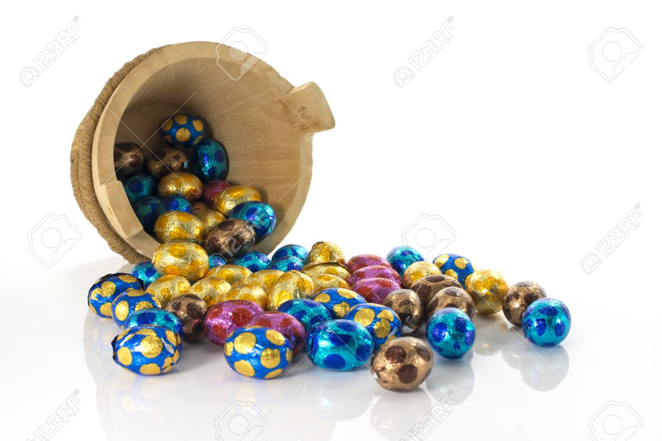 wooden bucket with easter eggs in red blue yellow and pink Stock Photo - 17452523
