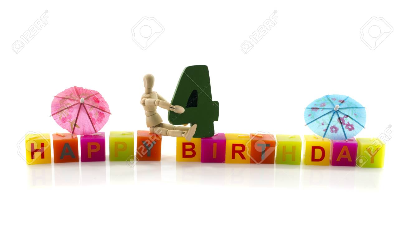 happy birthday candle letters with puppet and the number four Stock Photo - 17684254