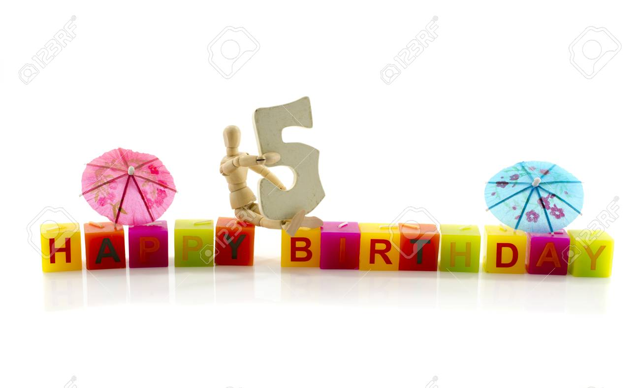 Happy Birthday Candle Letters With Puppet And The Number Five Stock Photo