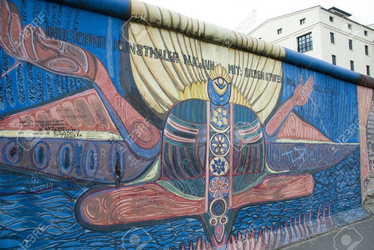 Berlin Wall Art graffiti art on east side gallery berlin wall stock photo, picture