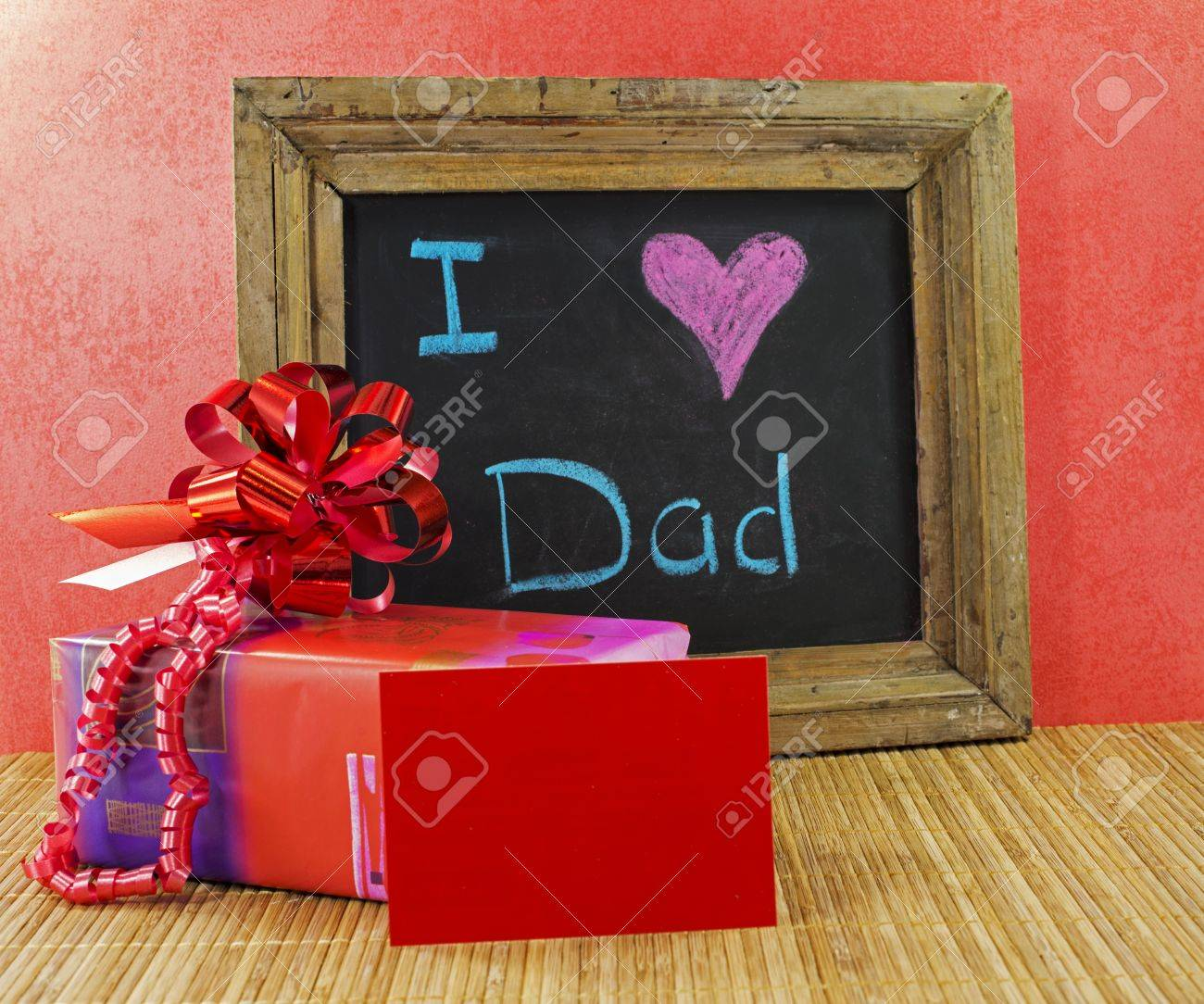 happy fathers day with present and blackboard with text i love dad - 19883252