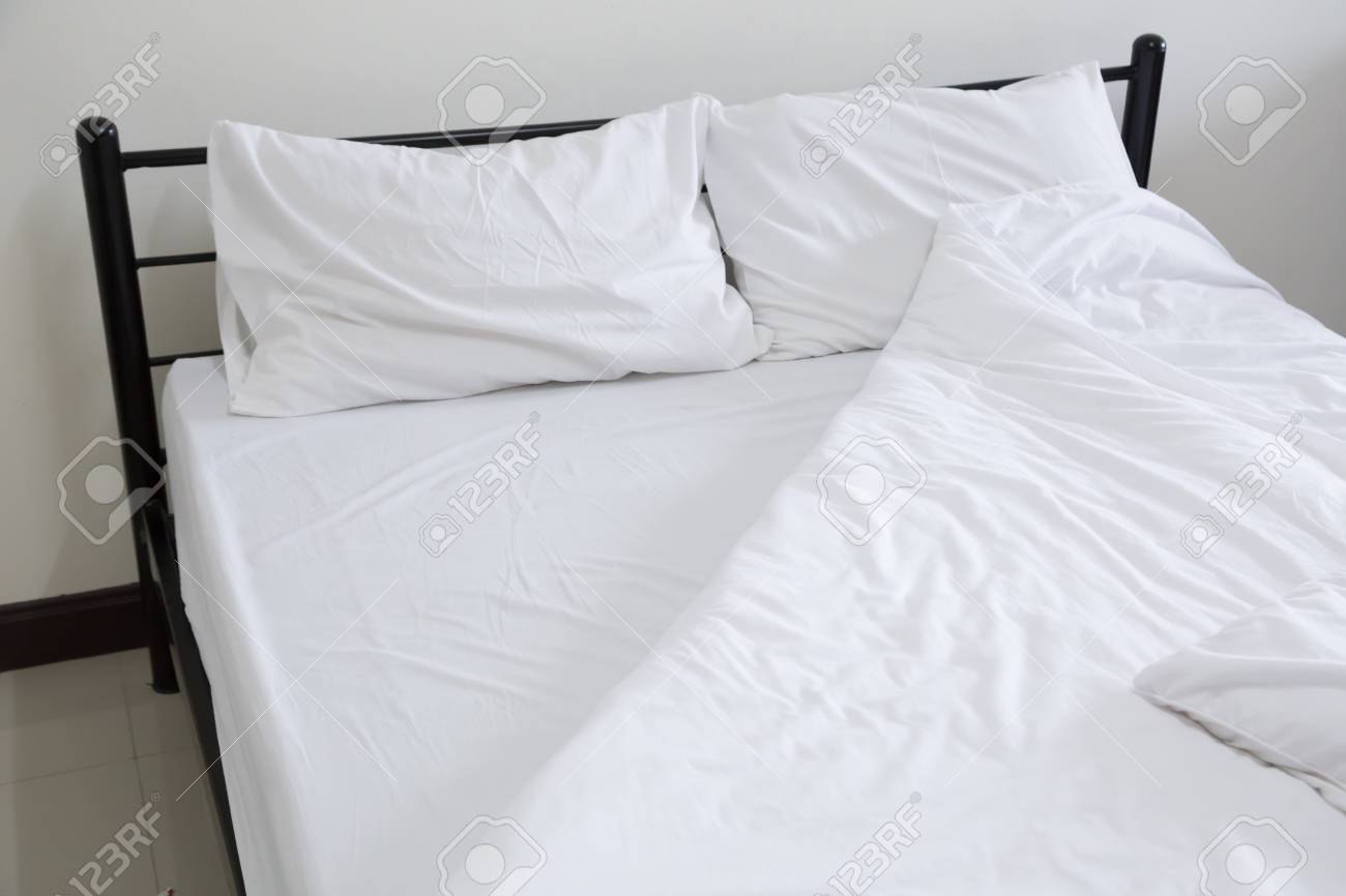 unmade bed side view. Stock Photo - View Of An Unmade Bed Side D