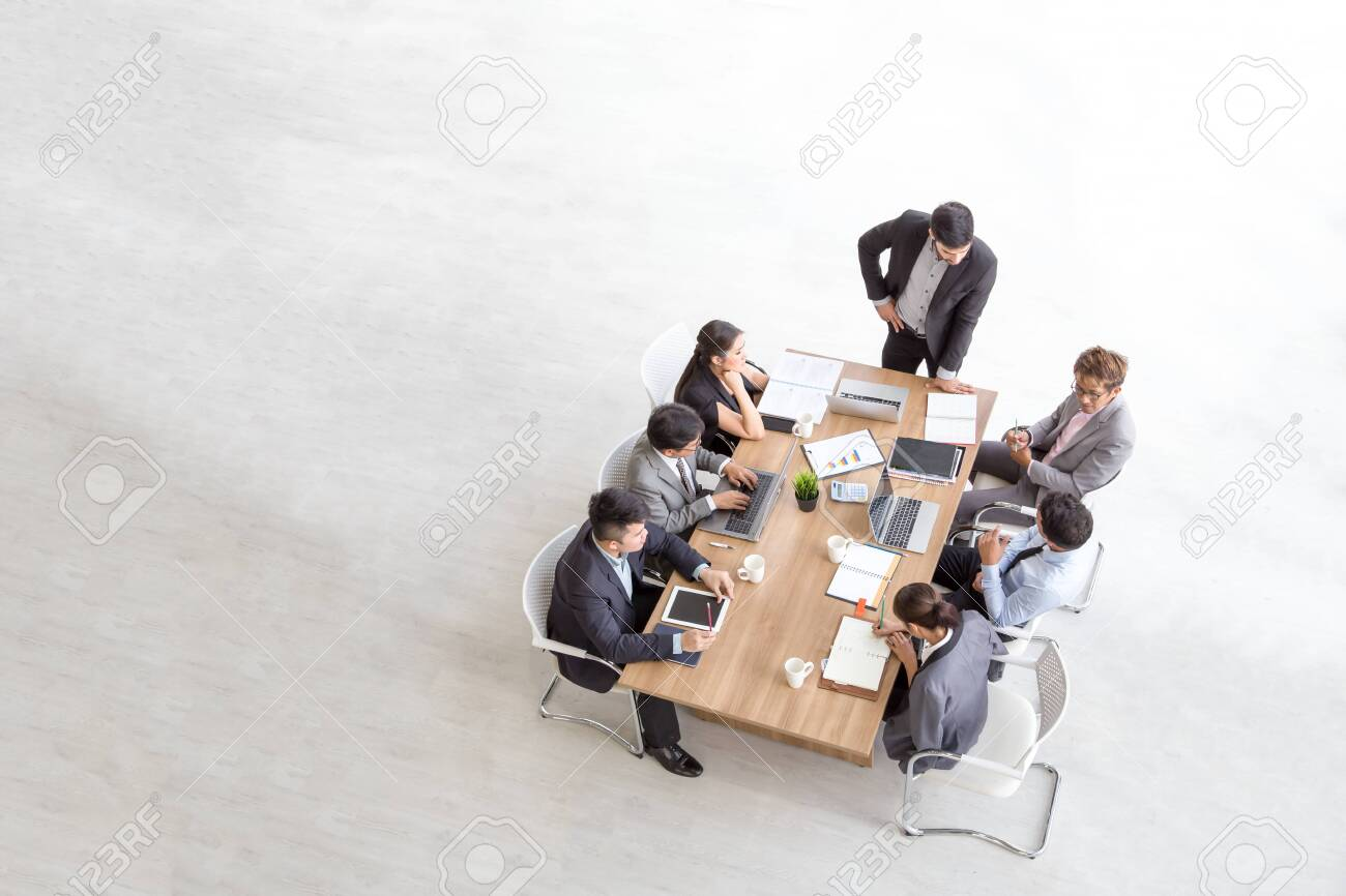 Top view of group of multiethnic busy people working in an office, Aerial view with businessman and businesswoman sitting around a conference table with blank copy space, Business meeting concept - 119576077