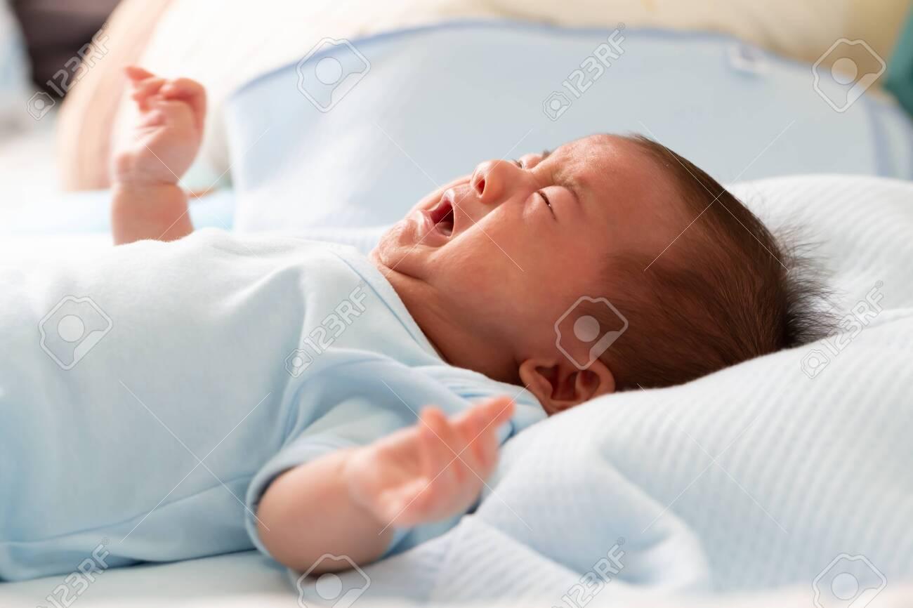 Asian baby newborn crying from diarrhea colic symptoms - 131280204