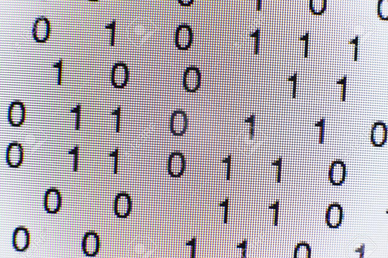 Binary code on a computer screen - 73026950