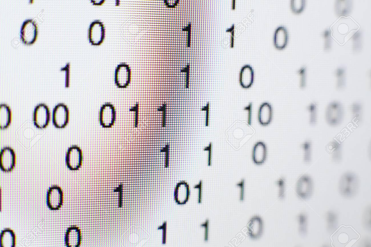 Binary code on a computer screen - 73026951