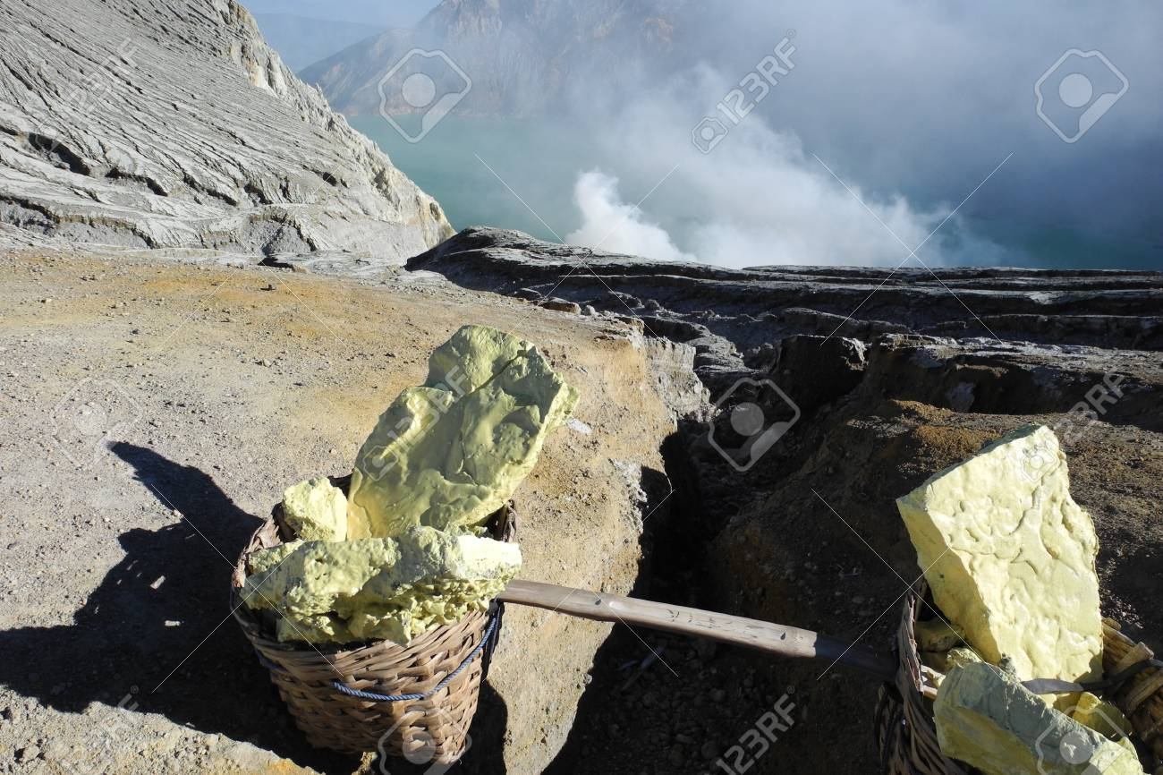 Sulfur workers on active Ijen volcano crater, Java, Indonesia Stock Photo - 25310104