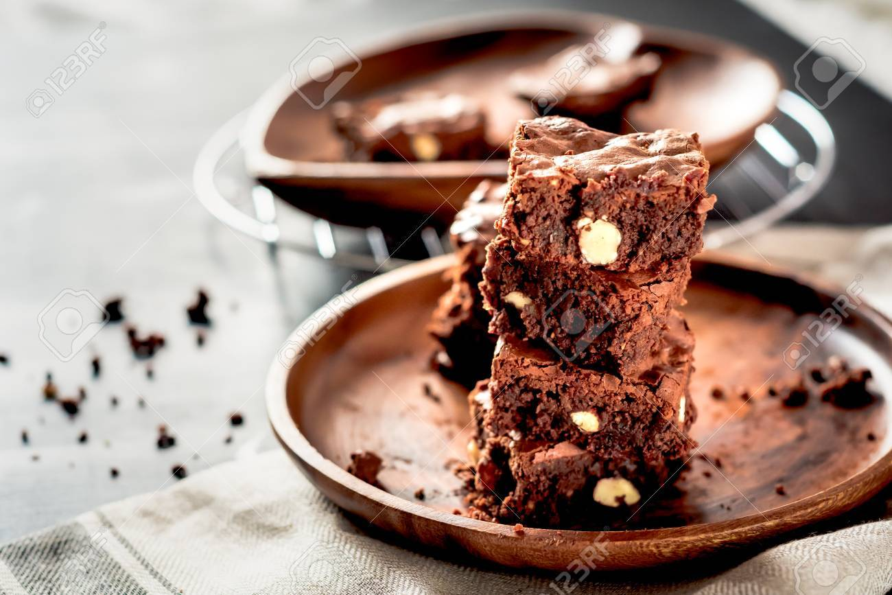Piece of stack homemade dark chocolate brownies topping with
