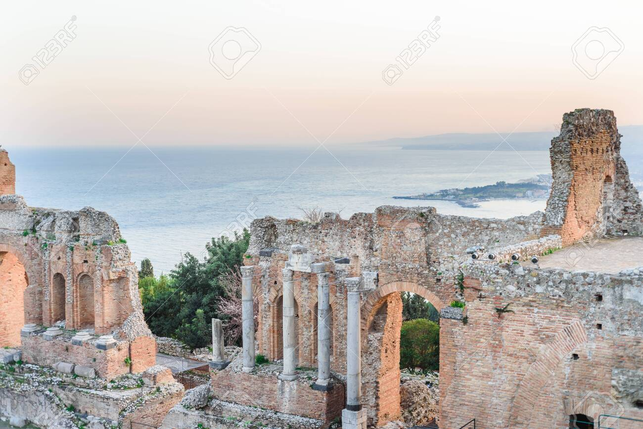 Greek reatre in Taormina Sicily, Italy, and Etna volcano in the background - 122063323