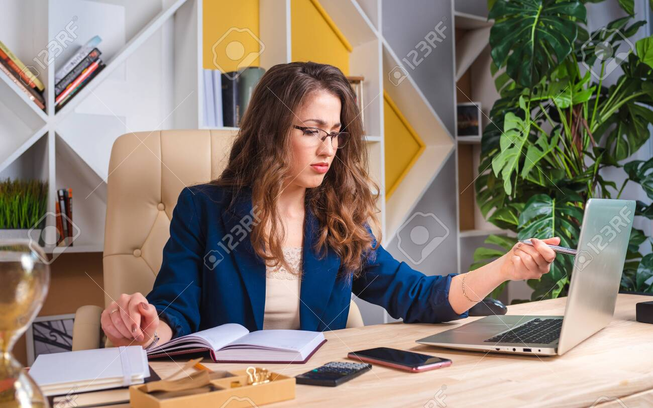 serious business lady is thinking about solving a business problem - 151138828