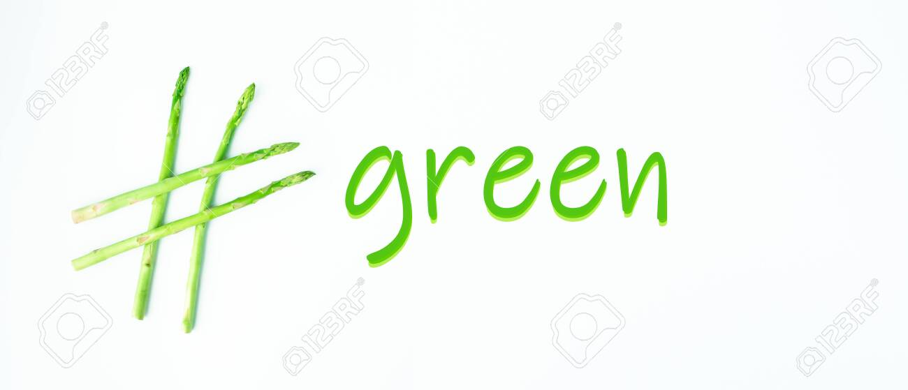 hashtag green, made of asparagus on a green background, creative idea, top view - 151865774