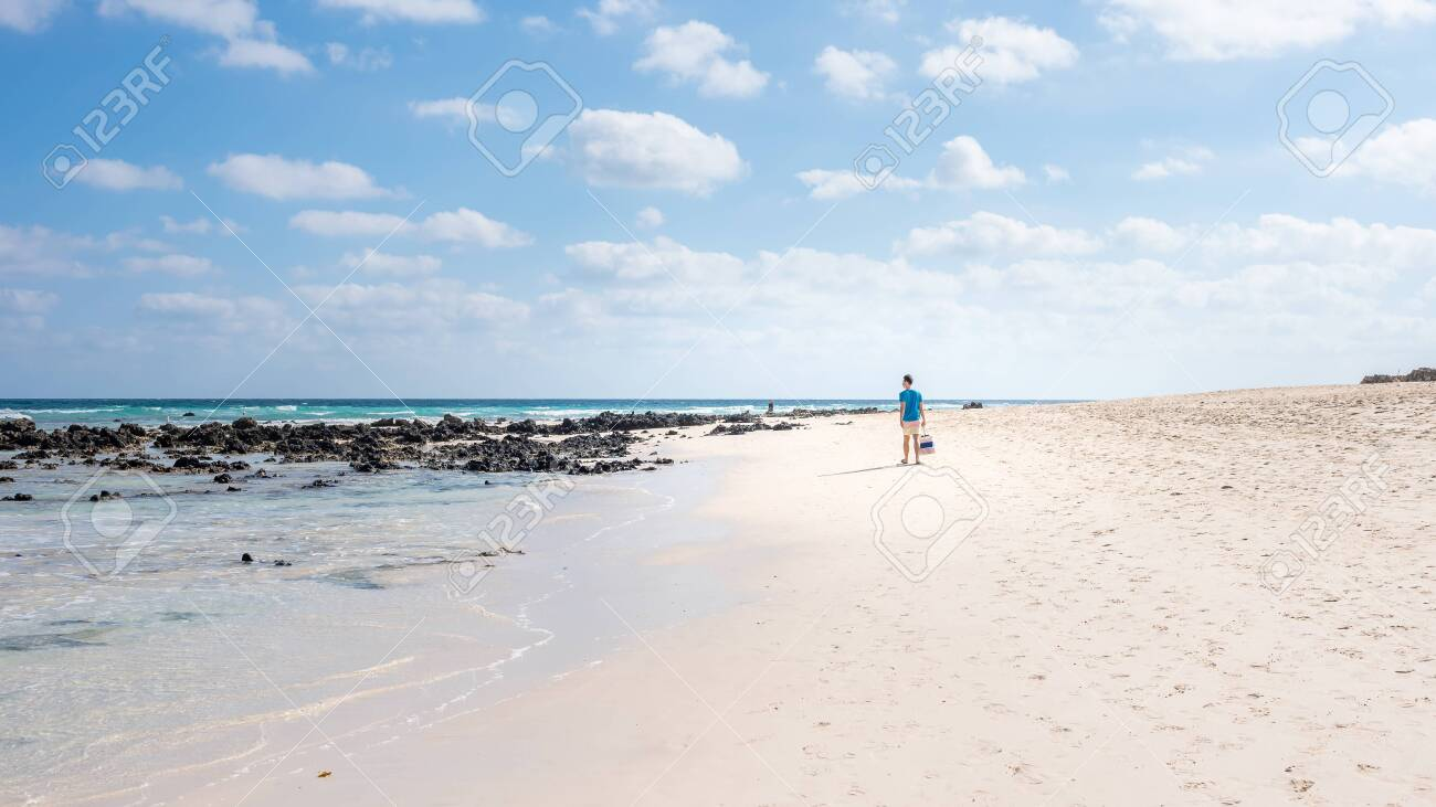 freedom concept, a man walks along the beach on the island of Fuerteventura Spain, Corralejo beach - 151798693