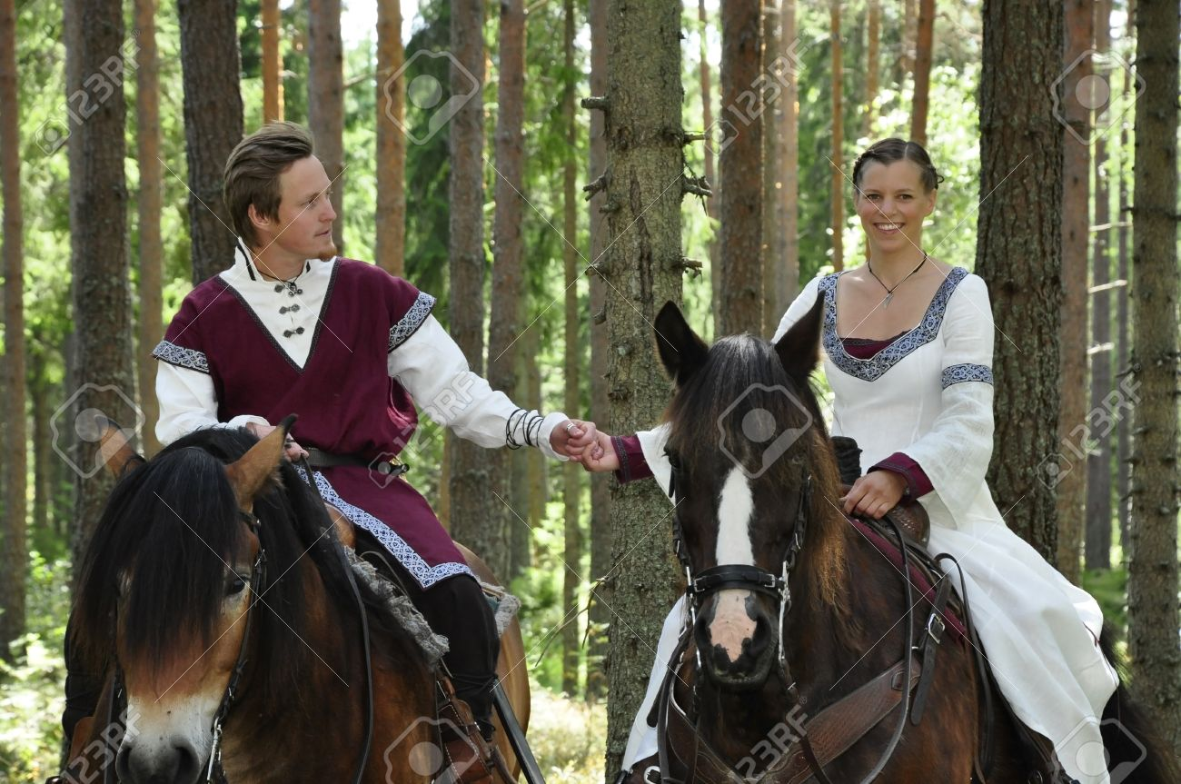 princess bride and her knight on horses wedding stock photo